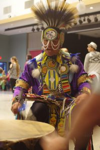 The Powwow Woodsmen been on the host drum and sing traditional songs for the dancers