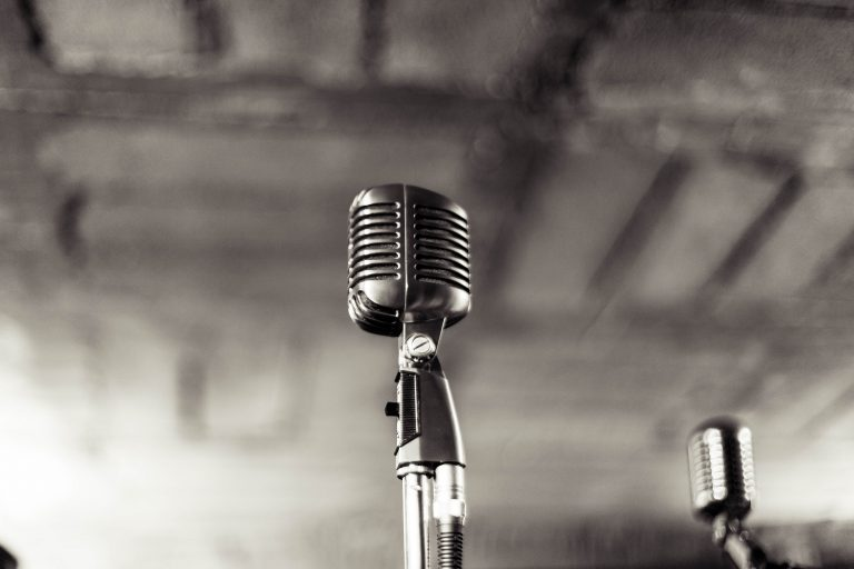 black and white picture of an old style microphone