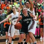 Kaylie Boschma tries to drive against Jasmine Miller (right) and Savannah Heugly/