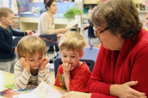 SMART volunteer Claire Woodruff reads to Marshall and Desmond