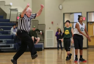 Millard Bates, 86, jumps while officiating a Skyball playoff game between teams from Waldo and Stephens middle schools