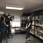 WOU Food Pantry Director Rebecca Hardgrave being interviewed by KPTV reporters.