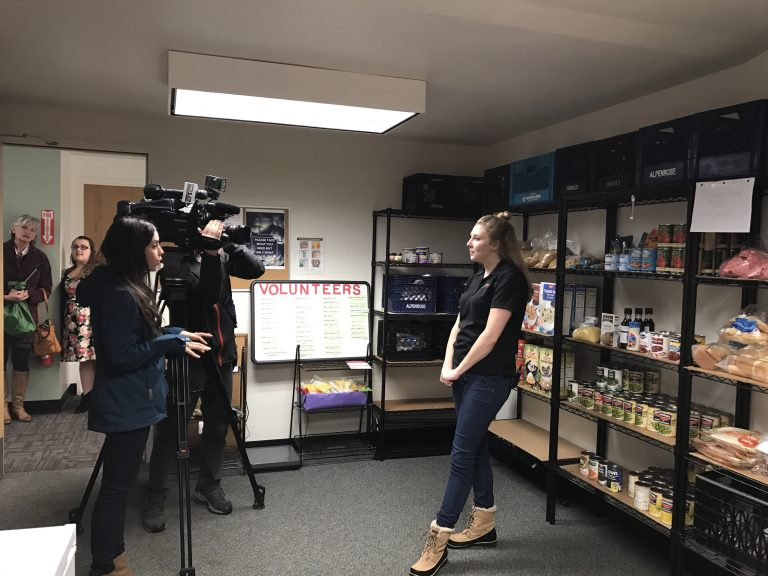 WOU Food Pantry Director Rebecca Hardgrave being interviewed by KPTV reporters.