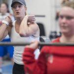 Cori Metzger encouraging Ariana Connally during weight lifting