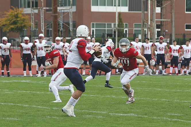 Western Oregon's football team in action.