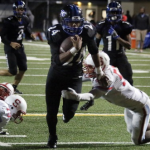 Photo of South Medford's Jaylin Parnell looks for the end-zone for a touchdown at the end of the 2nd quarter.