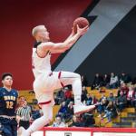 Western Oregon basketball's Tanner Omlid doing a layup.