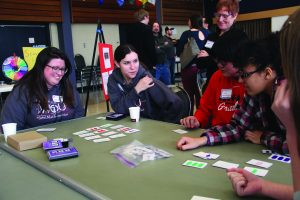 Feb. 23, 2018: Merrill and WOU senior Erica Stuckart played math games with students (bussed in from seven Oregon high schools) during WOU's annual Sonia Kovalevsky Day.