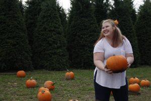Lila Gardner holding a pumpkin