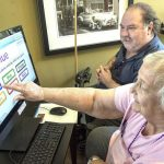 Carol Ray and Kurk Wilson play a game