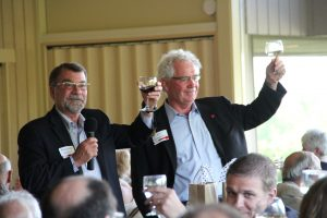 Rex Fuller and Jim Baumgartner toast donors at the President's Club dinner.
