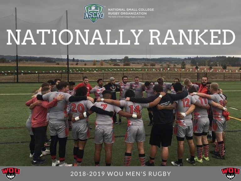 The 2018-19 WOU men's rugby team standing in a circle with arms around each other