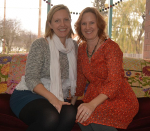 Chelsea Kirkaldie and Lori Paul are both smiling as they sit on a couch at their new place called MAXtivity.