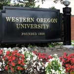 A photo of the Western Oregon University sign on campus.