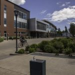 Sunny day on the WOU campus with someone riding a bike
