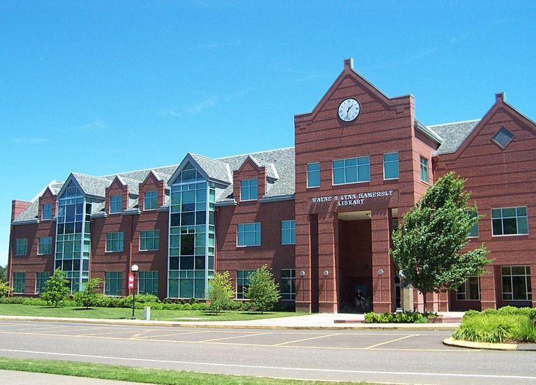 Street view of the large Hamersly Library, a three-story building with many windows.
