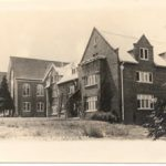 An old photograph of Todd Hall, a brick building pictured through sepia.