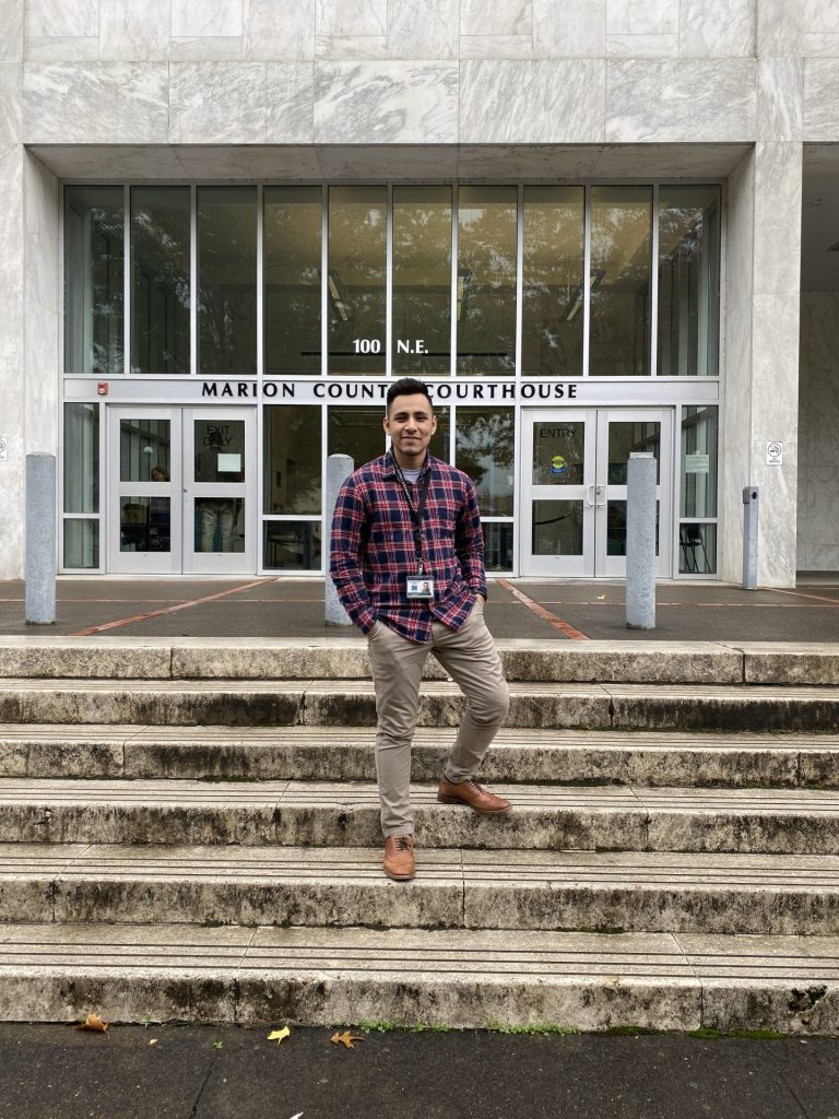 Leo Marquez standing on the stairs in front of the Marion County Courthouse.