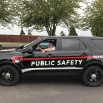 """Black SUV with words """"public safety"""" painted on it"""