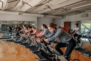 Row of students on bikes in a spin class