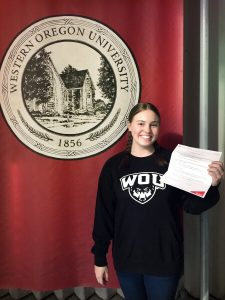 A person holds an acceptance letter.