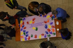 An aerial shot of a board with words and handprints.