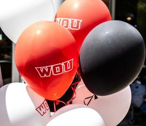 Red, white and black balloons with WOU