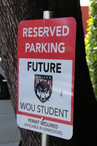A sign reading Reserved Parking Future WOU Student