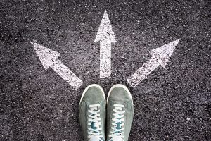 Three arrows going left, middle and right next to green sneakers.