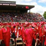 WOU Commencement. Students in cap and gowns celebrate their graduation.