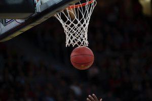 Basketball going through the net.