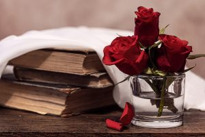 Roses next to books