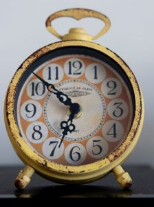 A faded yellow alarm clock