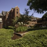 Exterior of Todd Hall and campus greenery with a blue sky