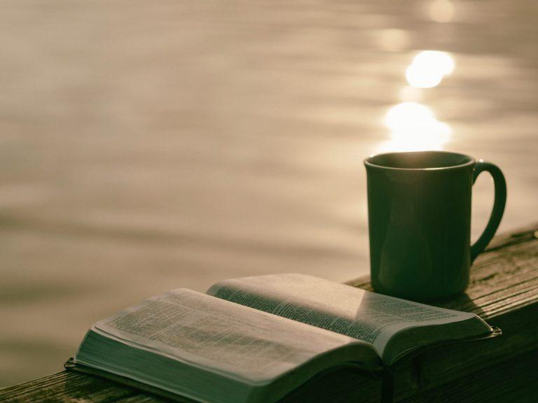A coffee mug and a book