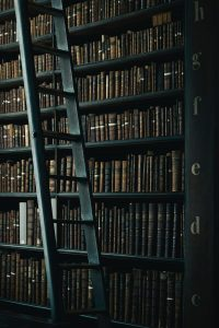 A ladder next to old books