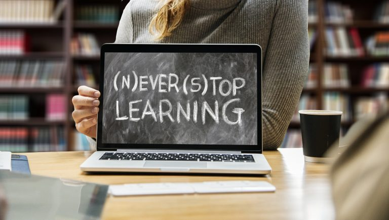 Picture of a computer screen reading Never Stop Learning