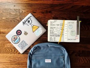 A computer, planner and backpack