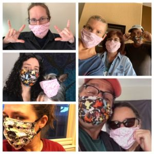 Several pepole wearing fabric face masks