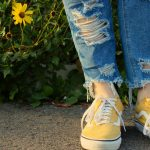 Torn jeans and sneakers