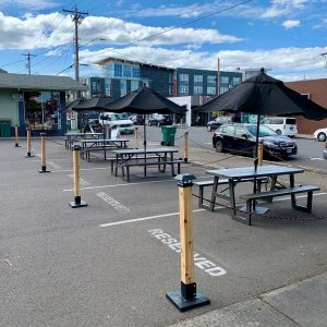Tables with umbrellas in a parking lot