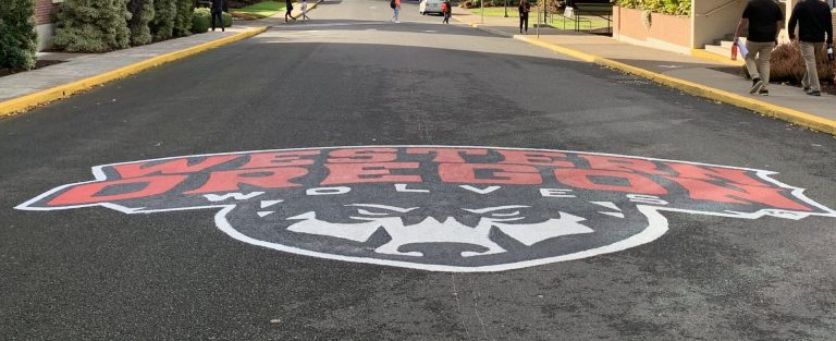 Western Oregon Wolves logo painted on a street