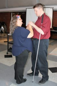 Two people standing and communicating with Protactile language