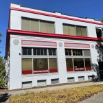 Front of WOU Salem Vick building with gray paint and red trim
